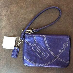 Coach small purple metallic wristlet